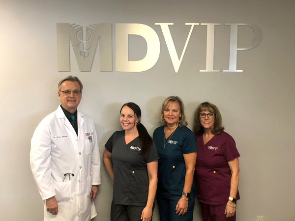 Dr. Morell and his staff in Brighton, MI